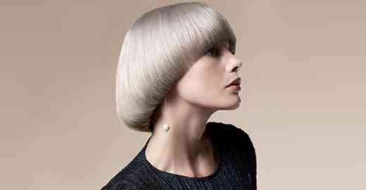 Woman with blond bowl cut