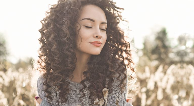 Beautiful woman with perm curls