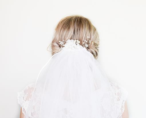 Beautiful DIY bridal hair with accessories and vail